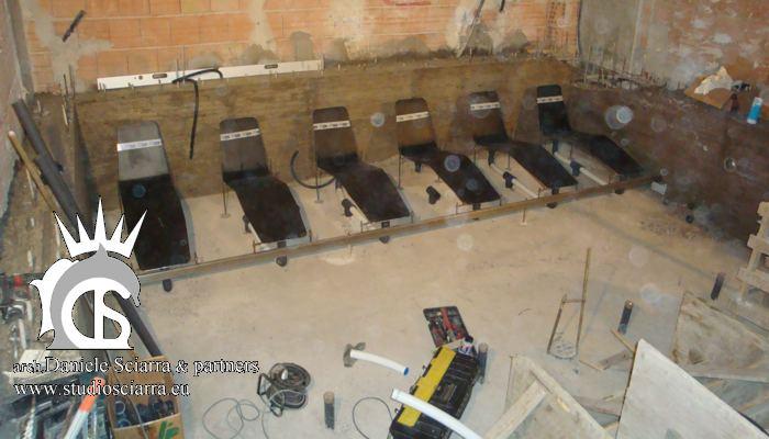 Realizzazione piscina idromassaggio con sedute e lettini idromassaggio